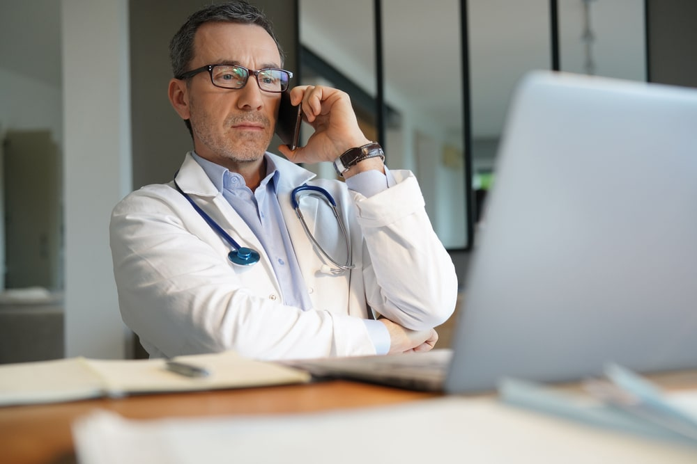 Doctor Talking Over Phone